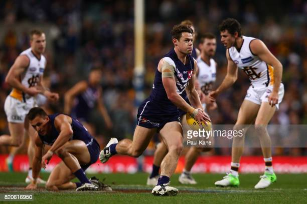 Lachie Neale of the Dockers looks to pass the ball during the round 18 AFL match between the Fremantle Dockers and the Hawthorn Hawks at Domain...