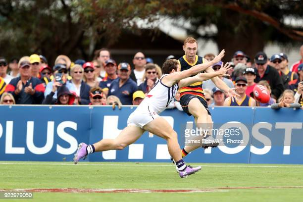Lachie Neale of the Dockers tackles Tom Lynch of the Crows during the AFL 2018 JLT Community Series match between the Adelaide Crows and the...