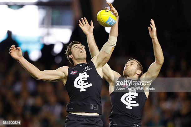 Lachie Plowman and Sam Docherty of the Blues compete for the ball during the 2016 AFL Round 08 match between the Carlton Blues and Port Adelaide...