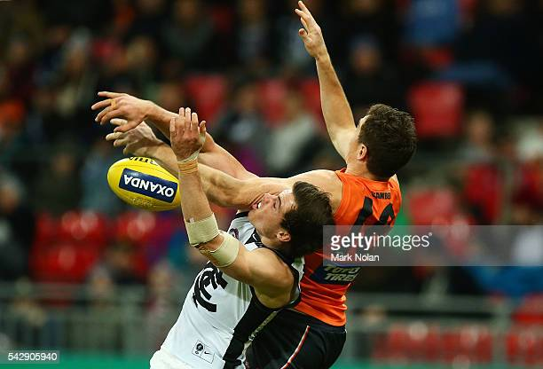 Lachie Plowman of Carlton and Jeremy Cameron of the Giants contest possession during the round 14 AFL match between the Greater Western Sydney Giants...
