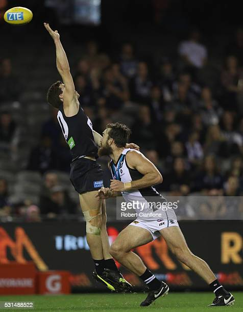 Lachie Plowman of the Blues and Justin Westhoff of Port Adelaide compete for the ball during the round eight AFL match between the Carlton Blues and...