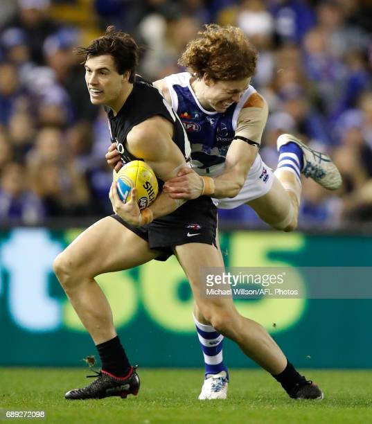 Lachie Plowman of the Blues and Shaun Higgins of the Kangaroos clash during the 2017 AFL round 10 match between the Carlton Blues and the North...