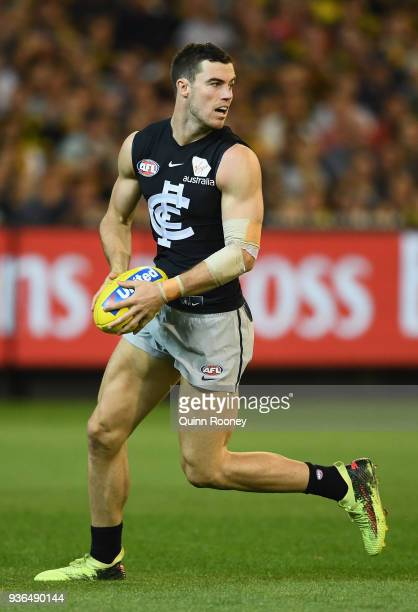 Lachie Plowman of the Blues kicks during the round one AFL match between the Richmond Tigers and the Carlton Blues at Melbourne Cricket Ground on...