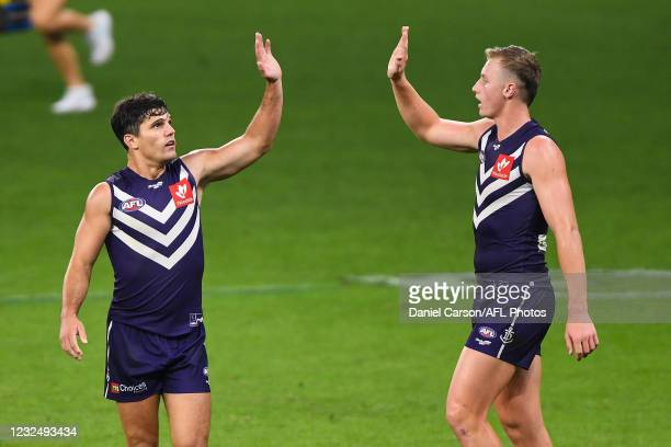 Lachie Schultz of the Dockers celebrates a goal during the 2021 AFL Round 06 match between the Fremantle Dockers and the North Melbourne Kangaroos at...