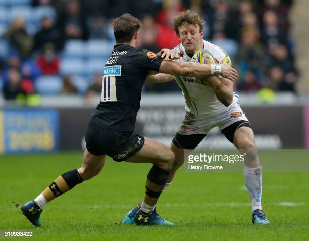 Lachie Turner of Exeter Chiefs and Josh Bassett of Wasps during the Aviva Premiership match between Wasps and Exeter Chiefs at The Ricoh Arena on...
