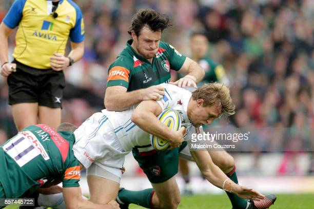 Lachie Turner of Exeter Chiefs is tackled by Matt Smith of Leicester Tigers during the Aviva Premiership game between Leicester Tigers and Exeter...