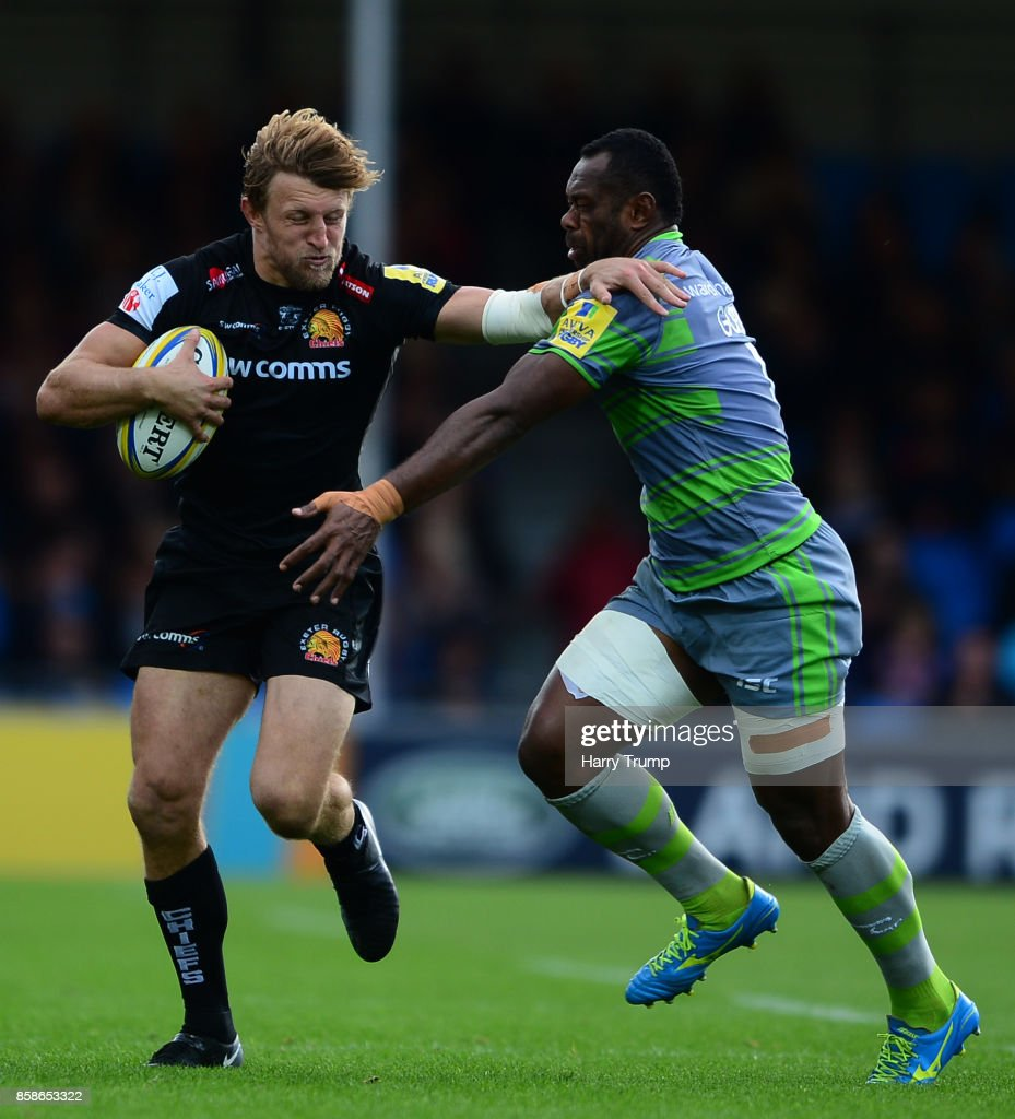 Lachie Turner of Exeter Chiefs is tackled by Vereniki Goneva of Newcastle Falcons during the Aviva Premiership match between Exeter Chiefs and Newcastle Falcons at Sandy Park on October 7, 2017 in Exeter, England.