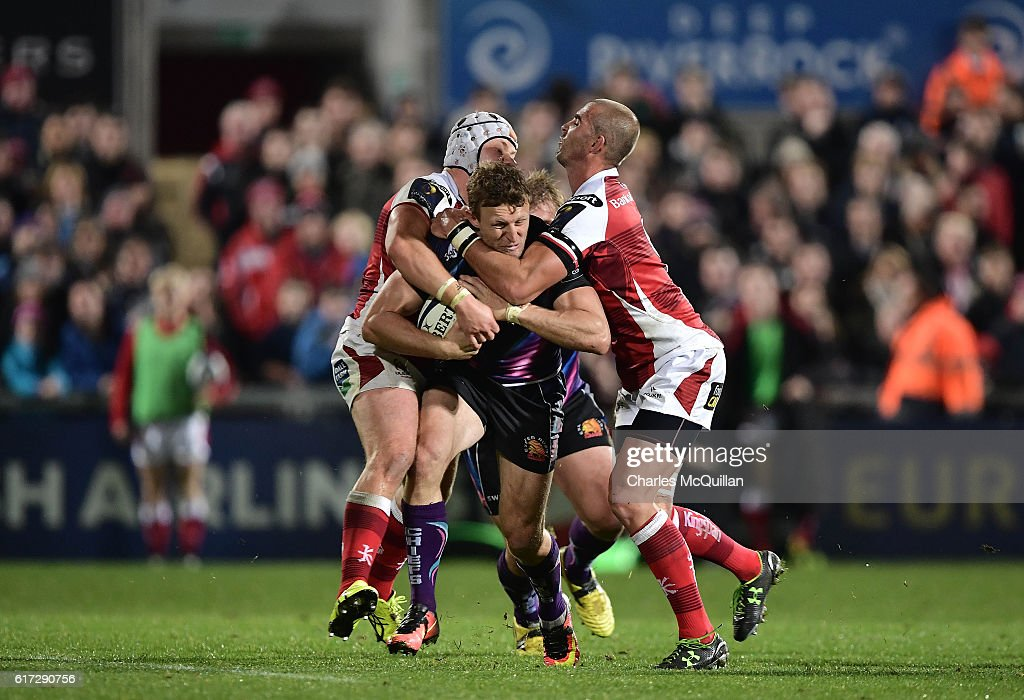 Lachie Turner of Exeter (C) is tackled by Ruan Pienaar (R) and Luke Marshall (L) of Ulster during the Champions Cup Pool 5 game at Kingspan Stadium on October 22, 2016 in Belfast, Northern Ireland.