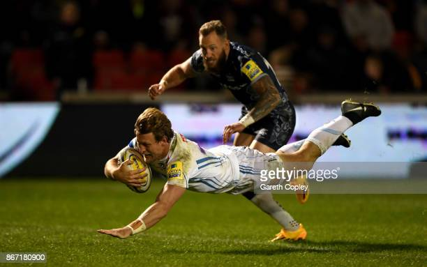Lachie Turner of Exeter scores the opening try past Byron McGuigan of Sale during the Aviva Premiership match between Sale Sharks and Exeter Chiefs...