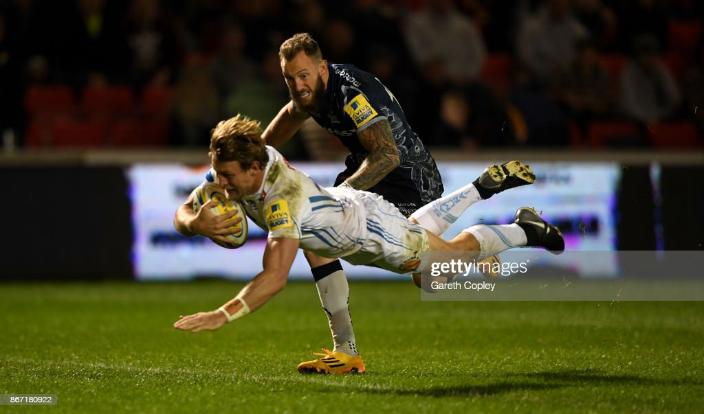 Lachie Turner of Exeter scores the opening try past Byron McGuigan of Sale during the Aviva Premiership match between Sale Sharks and Exeter Chiefs at AJ Bell Stadium on October 27, 2017 in Salford, England.