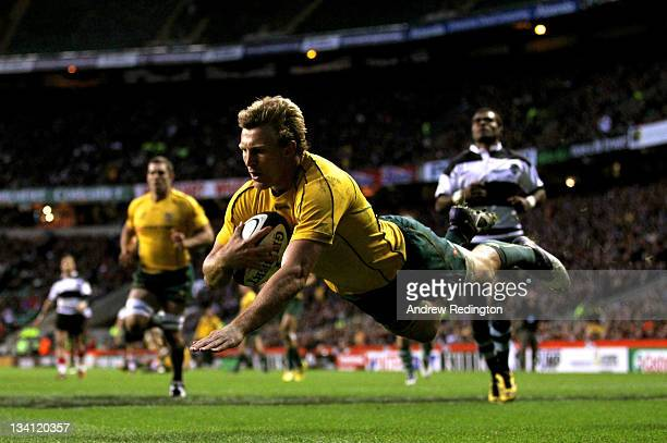 Lachie Turner of The Wallabies dives over to score his team's sixth try during the Killik Cup match between the Barbarians and Australia at...