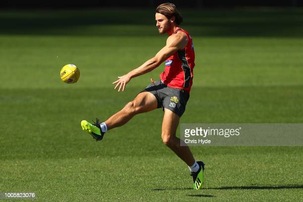 Lachie Weller kicks during a Gold Coast Suns AFL training session at Metricon Stadium on July 27 2018 in Gold Coast Australia