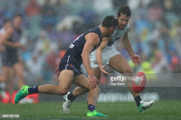 Lachie Weller of the Dockers and Matthew Wright of the Blues contest for the ball during the round nine AFL match between the Fremantle Dockers and...