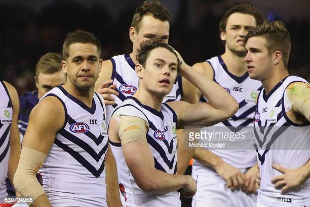 Lachie Weller of the Dockers and teammates after their defeat during the round 23 AFL match between the Essendon Bombers and the Fremantle Dockers at...