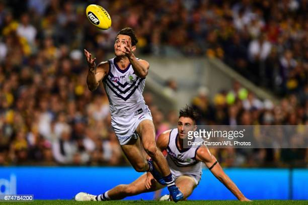 Lachie Weller of the Dockers gathers the ball during the 2017 AFL round 06 match between the West Coast Eagles and the Fremantle Dockers at Domain...