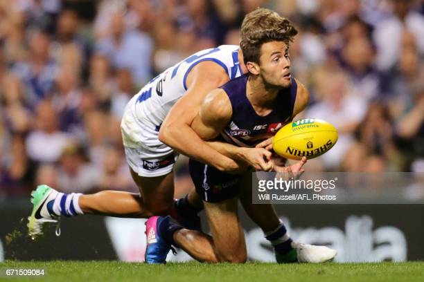 Lachie Weller of the Dockers is tackled by Mason Wood of the Kangaroos during the round five AFL match between the Fremantle Dockers and the North...