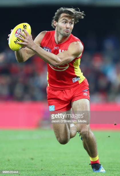 Lachie Weller of the Suns in action during the round 17 AFL match between the Gold Coast Suns and the Essendon Bombers at Metricon Stadium on July 14...