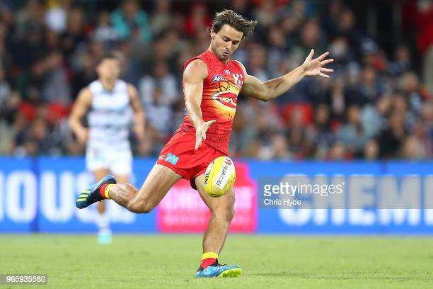 Lachie Weller of the Suns kicks during the round 11 AFL match between the Gold Coast Suns and the Geelong Cats at Metricon Stadium on June 2 2018 in...