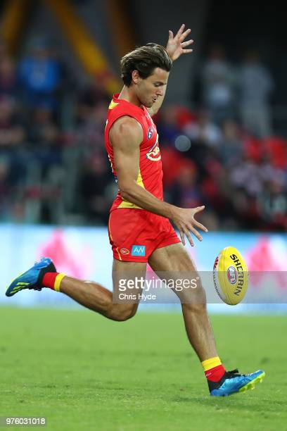Lachie Weller of the Suns kicks during the round 13 AFL match between the Gold Coast Suns and the St Kilda Saints at Metricon Stadium on June 16 2018...