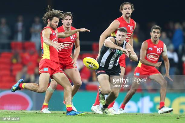 Lachie Weller of the Suns kicks during the round 15 AFL match between the Gold Coast Suns and the Collingwood Magpies at Metricon Stadium on June 30...