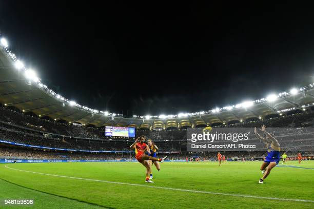 Lachie Weller of the Suns kicks the ball during the 2018 AFL Round 04 match between the West Coast Eagles and the Gold Coast Suns at Optus Stadium on...