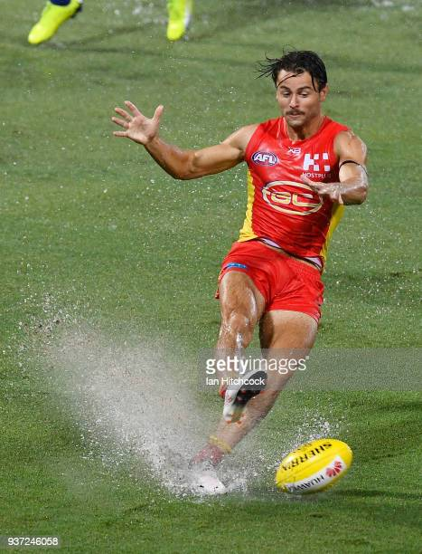 Lachie Weller of the Suns kicks the ball during the round one AFL match between the Gold Coast Suns and the North Melbourne Kangaroos at Cazaly's...