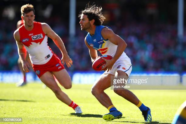 Lachie Weller of the Suns runs the ball during the round 18 AFL match between the Sydney Swans and the Gold Coast Suns at Sydney Cricket Ground on...
