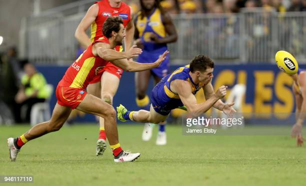 Lachie Weller of the Suns tackles Luke Shuey of the Eagles during the round four AFL match between the West Coast Eagles and the Gold Coast Suns at...