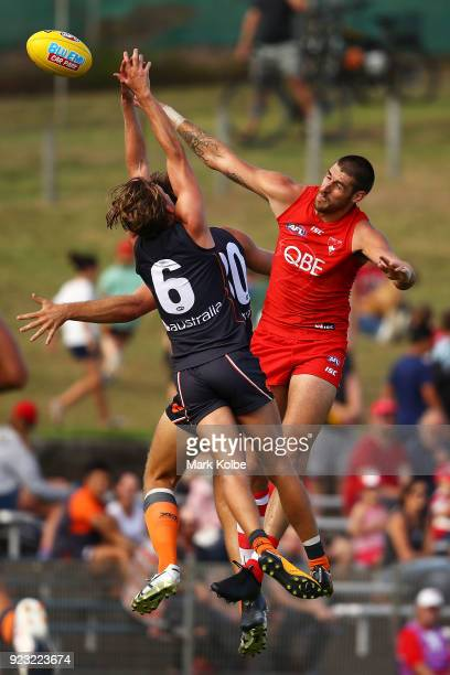 Lachie Whitfield and Matt Flynn of the Giants compete for the ball with Sam Naismith of the Swans during the AFL Inter Club match between the Sydney...