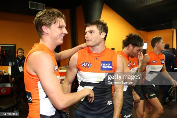 Lachie Whitfield of the Giants and Heath Shaw of the Giants embrace after winning the AFL First Semi Final match between the Greater Western Sydney...