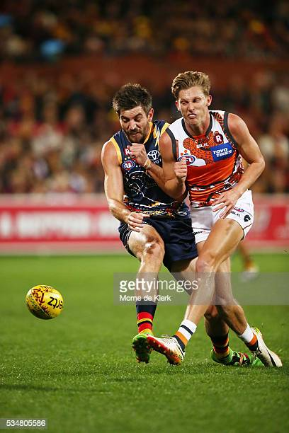 Lachie Whitfield of the Giants bumps Ricky Henderson of the Crows during the round 10 AFL match between the Adelaide Crows and the Greater Western...