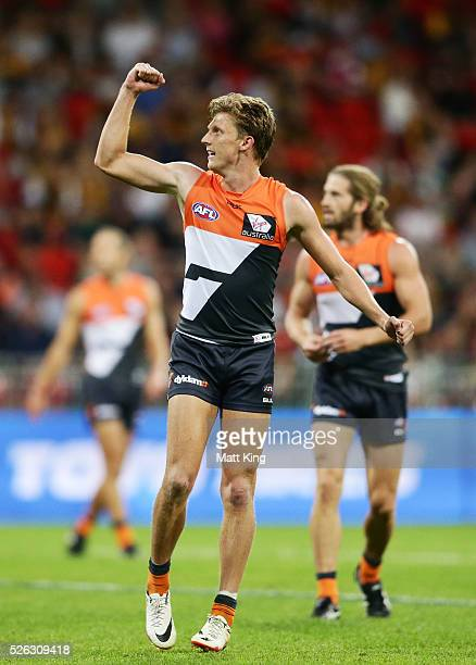Lachie Whitfield of the Giants celebrates a goal during the round six AFL match between the Greater Western Sydney Giants and the Hawthorn Hawks at...