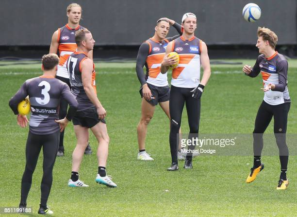 Lachie Whitfield of the Giants heads the soccer ball during the Greater Western Sydney Giants AFL training session at Melbourne Cricket Ground on...