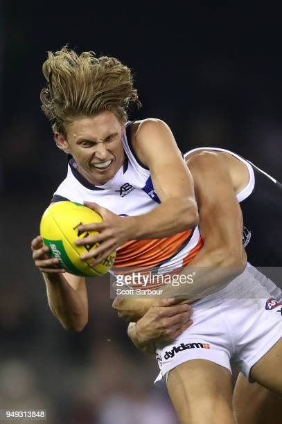 Lachie Whitfield of the Giants is tackled by Maverick Weller of the Saints during the round five AFL match between the St Kilda Saints and the...