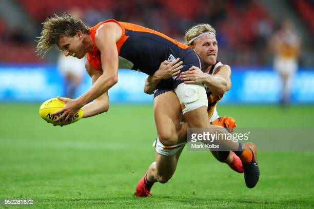 Lachie Whitfield of the Giants is tackled Daniel Rich of the Lions during the round six AFL match between the Greater Western Sydney Giants and the...