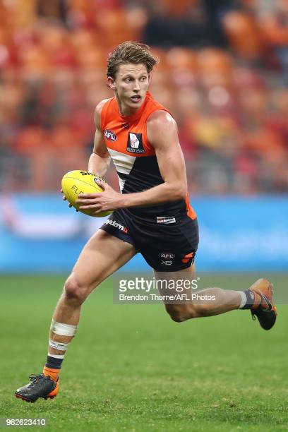 Lachie Whitfield of the Giants runs during the round 10 AFL match between the Greater Western Sydney Giants and the Essendon Bombers at Spotless...