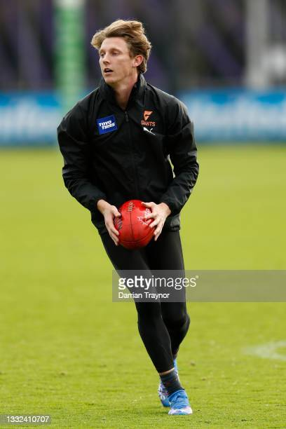 Lachie Whitfield of the Giants runs with the ball during a Greater Western Sydney Giants AFL training session at Holden Centre on August 05, 2021 in...