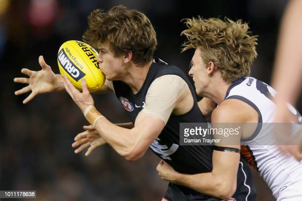Lachie Whitfield of the Giants tackles Paddy Dow of the Blues during the round 20 AFL match between the Carlton Blues and the Greater Western Sydney...