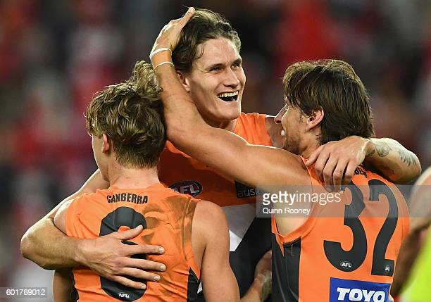 Lachie Whitfield Rory Lobb and Ryan Griffen of the Giants celebrate winning the AFL 1st Qualifying Final match between the Sydney Swans and the...