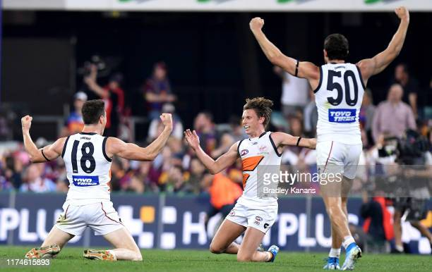 Lachie Whitfield, Sam Reid and Jeremy Cameron of the Giants celebrate victory after the AFL Semi Final match between the Brisbane Lions and the...