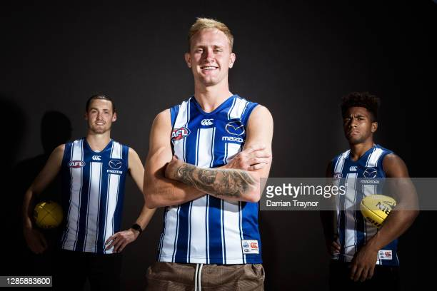 Lachie Young, Jaidyn Stephenson and Atu Bosenavulagi pose for a photo during a North Melbourne Kangaroos AFL media opportunity at Arden Street Ground...