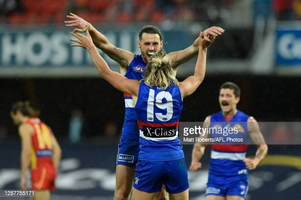 Lachie Young of the Bulldogs celebrates kicking a goal during the round 8 AFL match between the Gold Coast Suns and Western Bulldogs at Metricon...