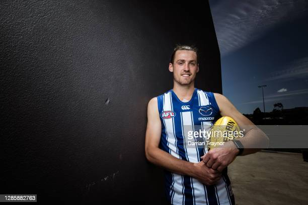 Lachie Young poses for a photo during a North Melbourne Kangaroos AFL media opportunity at Arden Street Ground on November 16, 2020 in Melbourne,...