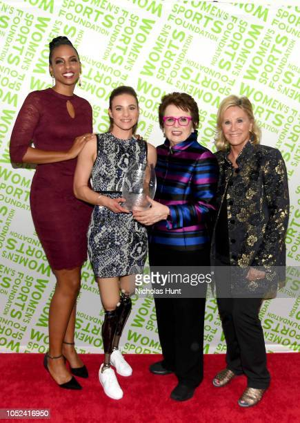 LaChina Robinson Oksana Masters Billie Jean King and Donna de Varona pose with an award backstage during The Women's Sports Foundation's 39th Annual...