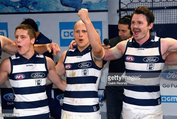 Lachine Fogarty Gary Ablett and Patrick Dangerfield of the Cats sing the song in the rooms after winning the round 12 AFL match between the Geelong...