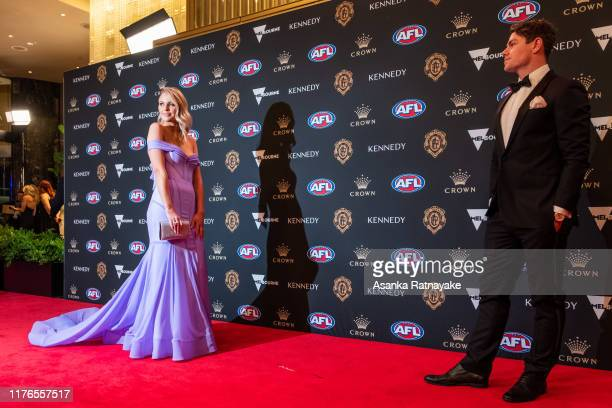 Lachine Neale of the Lions and his partner Julie Neale arrives ahead of the 2019 Brownlow Medal at Crown Palladium on September 23, 2019 in...