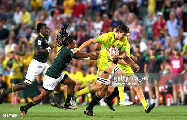 Lachlan Anderson of Australia breaks away from the defence in the MenÕs final match against South Africa during day three of the 2018 Sydney Sevens...