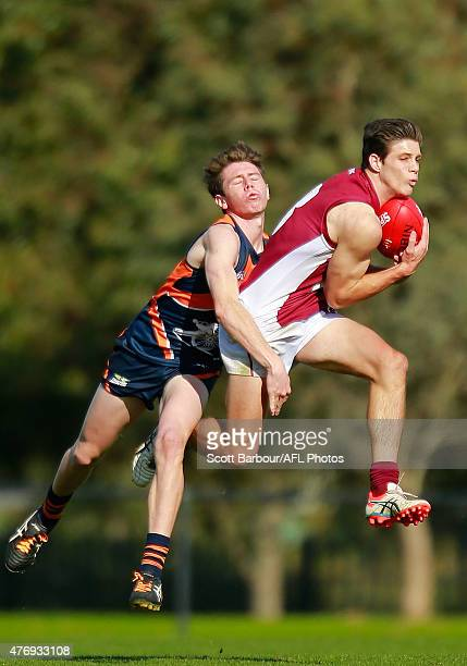 Lachlan Bramble of the Cannons and Connor West of Queensland compete for the ball during the round 10 TAC Cup match between the Calder Cannons and...