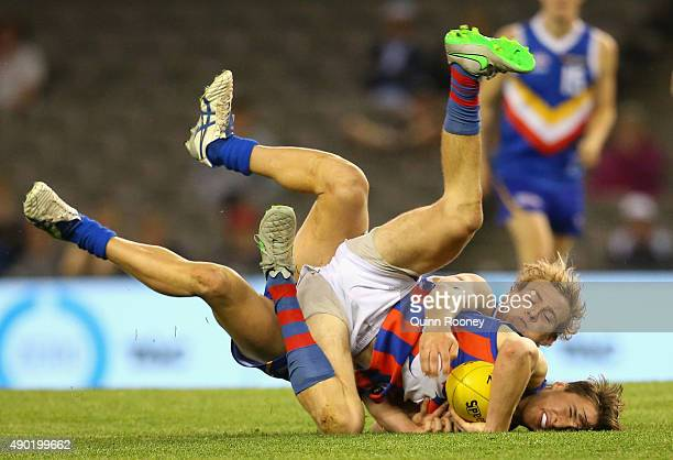 Lachlan ByrneJones of the Chargers is tackled during the TAC Cup Grand Final match between the Eastern Ranges and the Oakleigh Chargers at Etihad...