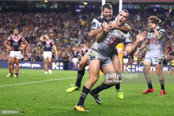 Lachlan Coote and Kane Linnett of the Cowboys celebrate Kane Linnett scoring a try during the NRL Preliminary Final match between the Sydney Roosters...